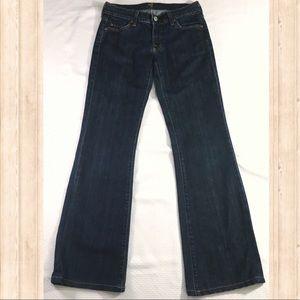 7 FAM dark rinse boot cut jeans